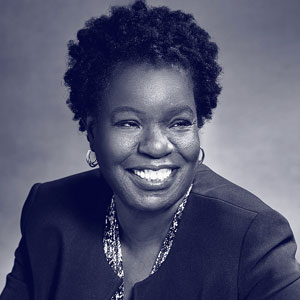 Middle aged black woman with afro in suit