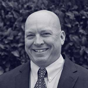 Older bald white man in suit