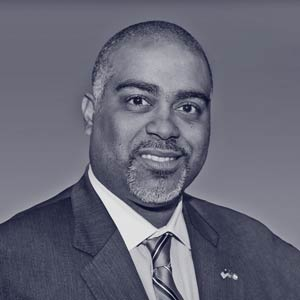 Middle aged black man in suit and smile