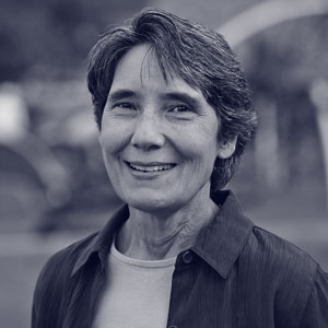 White middle aged woman with short hair smiling at the camera
