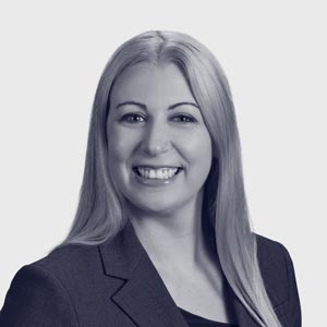 Young white woman with long blonde hair in dark suit