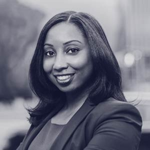 Young black woman in suit