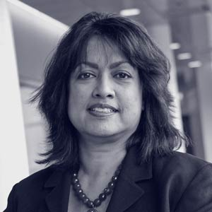 Middle aged Indian-American woman smiling at camera