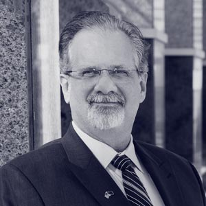 Old white man with glasses and suit and tie