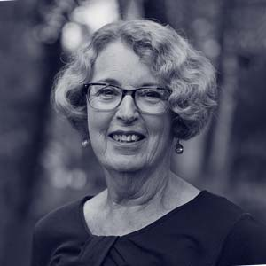 Older white woman in dark suit